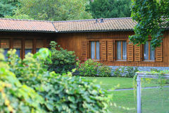 Wooden house in the woods. Nice-looking estate, wooden house in garden Stock Image