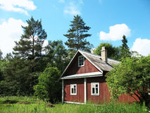 Wooden house in the woods Stock Images
