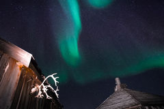 Wooden house, yurt hut on the background the polar Northern aurora borealis lights Royalty Free Stock Photography