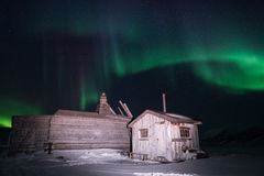 Wooden house, yurt hut on the background the polar Northern aurora borealis lights Stock Images