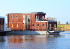 Wooden houseboat with two floors in lake Royalty Free Stock Photo