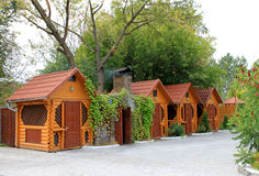 Wooden houses. Colored wooden houses and trees Royalty Free Stock Photos