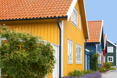 Wooden houses. Street of wooden colorful houses Stock Images