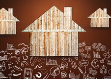Wooden houses against brown background with drawings of plans and charts. Digital composite of Wooden houses against brown background with drawings of plans and Royalty Free Stock Image