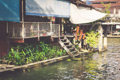 Wooden houses along the canals river, Thailand Royalty Free Stock Photos