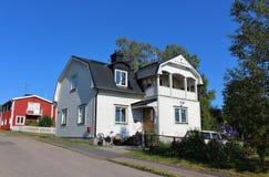Wooden houses. Along a street in Svartöstan in Lule Royalty Free Stock Photo