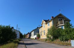 Wooden houses. Along a street in Svartöstan in Lule Stock Image