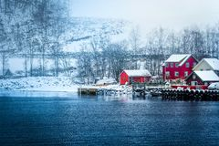 Norwegian Fjords. Wooden houses on the banks of the Norwegian fjord, beautiful mountain landscape in winter Royalty Free Stock Photos