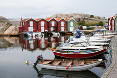 Wooden Houses. With boats in a harbor Stock Images