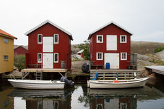 Wooden Houses. With boats in a harbor Stock Photography