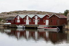 Wooden Houses. With boats in a harbor Royalty Free Stock Photos