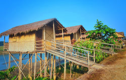 Wooden houses built on high stilts called in Chitwan Royalty Free Stock Images