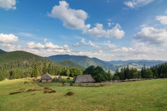 Wooden houses in the Carpathian Mountains with views of the mountains. Synevir. Royalty Free Stock Photo