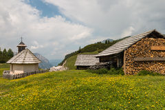 Wooden houses and chapel in Dolomites Stock Image