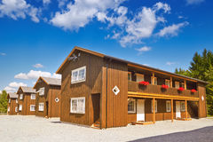 Wooden houses in cloudy summer day Stock Photo