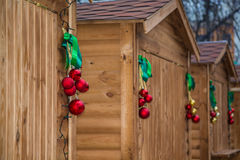 Wooden houses decorated with ribbons and Christmas decorations garland Christmas Eve and New Year,. Wooden houses decorated with ribbons and Christmas Royalty Free Stock Images