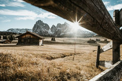 Wooden houses on the foot of a mountain Royalty Free Stock Photos