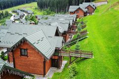 Wooden houses with green roofs in the Carpathian mountains. Ukraine royalty free stock image