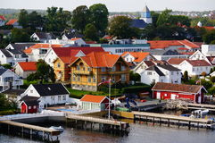 Wooden houses inport town, Norway. Areal view on norwegian port. View from ferry sailing on the fjord. Voyage from Hirtshals in Norway to Langesund in Denmark Stock Photos