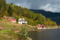 Wooden houses on a lake coast Royalty Free Stock Image