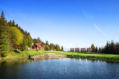 Wooden houses on the lake Stock Images