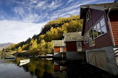 Wooden houses near the lake. Small red wooden houses near the lake Stock Photos