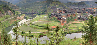 Wooden houses peasants in the mountainous village agriculture Ch Stock Photography