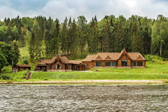Wooden houses by the river Stock Images
