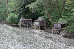 Wooden Houses in the River Stock Image
