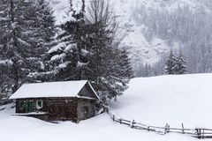 Wooden houses on Romanian mountains at winter Stock Image