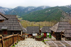 Wooden houses. On the slope of the mountain lies a small village of wooden houses, between the houses mountains. the village kusturicas drvengrad (mecavnik) in Royalty Free Stock Image