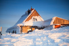 Wooden houses in snowy scenery.  Stock Photos