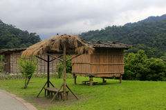 Wooden houses on stilts in the farm of wulaokeng scenic area Royalty Free Stock Photos