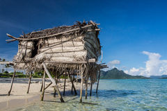 Wooden Houses on stilts Floating on the ocean Stock Photography