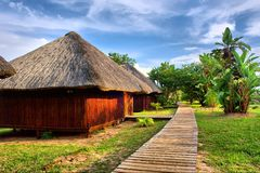 Wooden houses in tropical lodge park Stock Photos