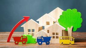 Wooden houses, vehicles, trees and up arrow. The concept of increasing air pollution. The growth of traffic in the city. Favorable royalty free stock images