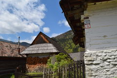 Wooden houses in Vlkolinec, UNESCO in Slovakia. Traditional architecture in village Vlkolinec, on list UNESCO, Slovakia. Wooden houses and street in protected stock photo
