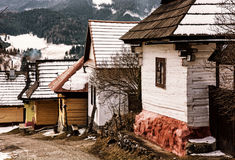 Wooden houses in Vlkolinec village, Slovakia, yellow filter Royalty Free Stock Images