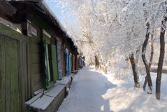 Wooden houses in winter. Wooden houses and trees in winter Royalty Free Stock Image