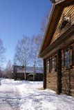 Wooden houses in winter stock photography