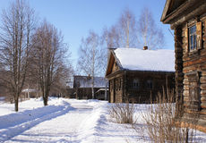 Wooden houses in winter stock photos
