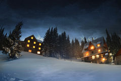 Wooden houses in winter forest, Dragobrat Royalty Free Stock Photos