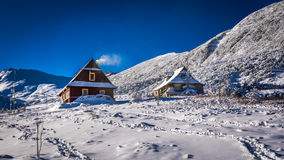 Wooden houses in winter mountains Royalty Free Stock Image