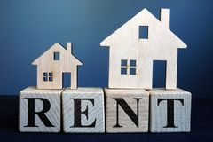 Wooden houses and word rent. Real estate renting royalty free stock photo