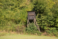 Wooden hunter's stand in the forest Stock Photos