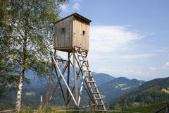 Wooden hunters high tower. Hunters high seat. Stock Photos
