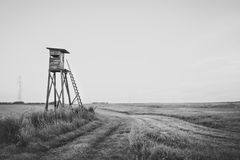 Wooden Hunting high tower. Hunters tower. Wooden Hunting high tower on the meadow. Hunters lookout tower stock photography