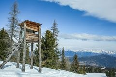Wooden hunting tower in the winter forest in the mountains stock images