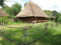 Wooden hut. With thatch roof, Ukraine Stock Photo
