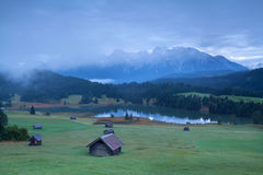 Wooden hut on alpine meadows in morning Stock Photos